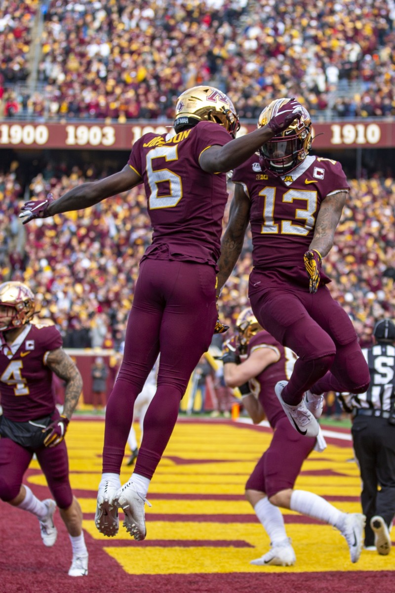 Nov 9, 2019; Minneapolis, MN, USA; Minnesota Golden Gophers wide receiver Rashod Bateman (13) celebrates with wide receiver Tyler Johnson (6) after scoring a touchdown in the first quarter against the Penn State Nittany Lions at TCF Bank Stadium. Mandatory Credit: Jesse Johnson-USA TODAY Sports
