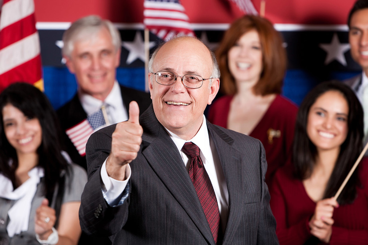 """""""On behalf of The People, I, stock photo model of 'Mature Male Politician,' hereby approve of this mock draft."""""""