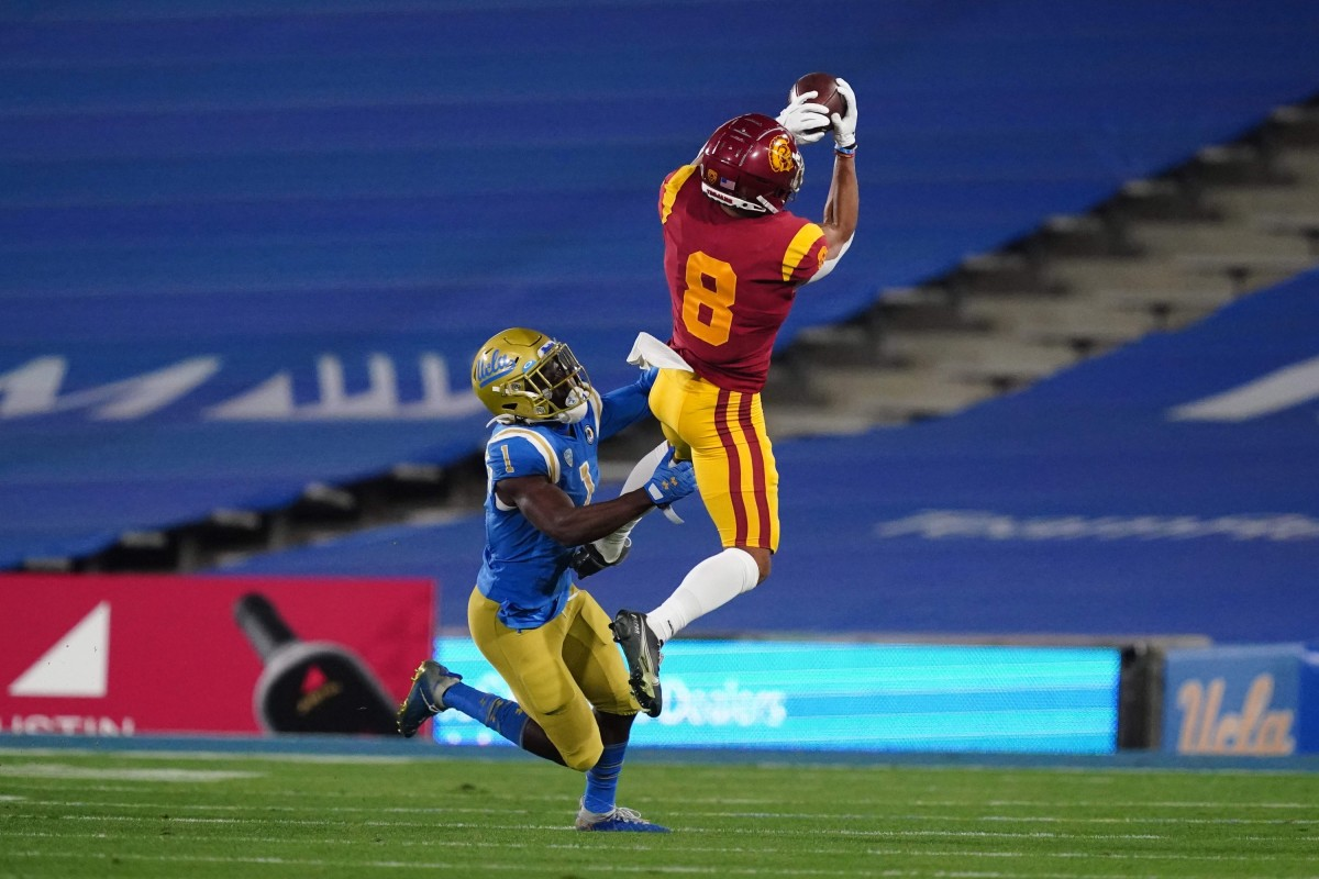 Southern California receiver Amon-Ra St. Brown (8) catches a pass as UCLA Bruins defensive back Jay Shaw (1) defends. Mandatory Credit: Kirby Lee-USA TODAY Sports