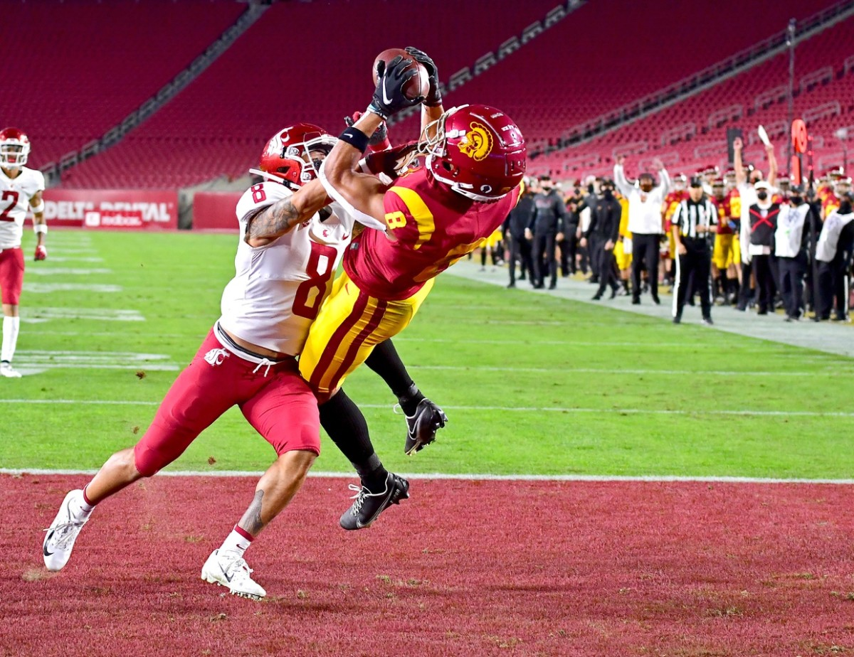 USC Trojans wide receiver Amon-Ra St. Brown (8) catches a touchdown pass in front Washington State defensive back Armani Marsh (8). Mandatory Credit: Jayne Kamin-Oncea-USA TODAY Sports