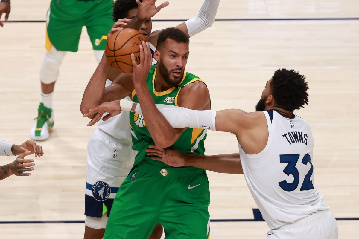 Rudy Gobert (27) and Karl Anthony Towns (32) will go head to head once again later this evening