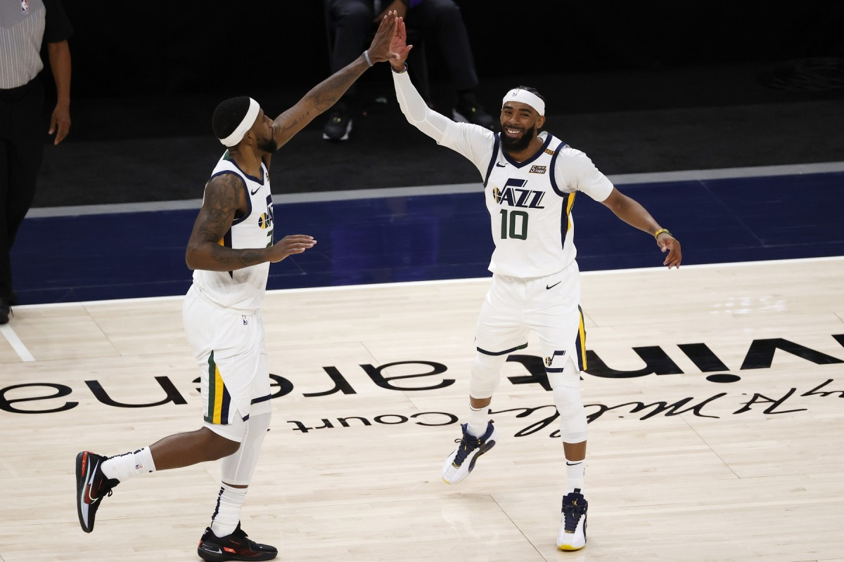 Mike Conley (10) and Royce O'Neale (23) celebrate