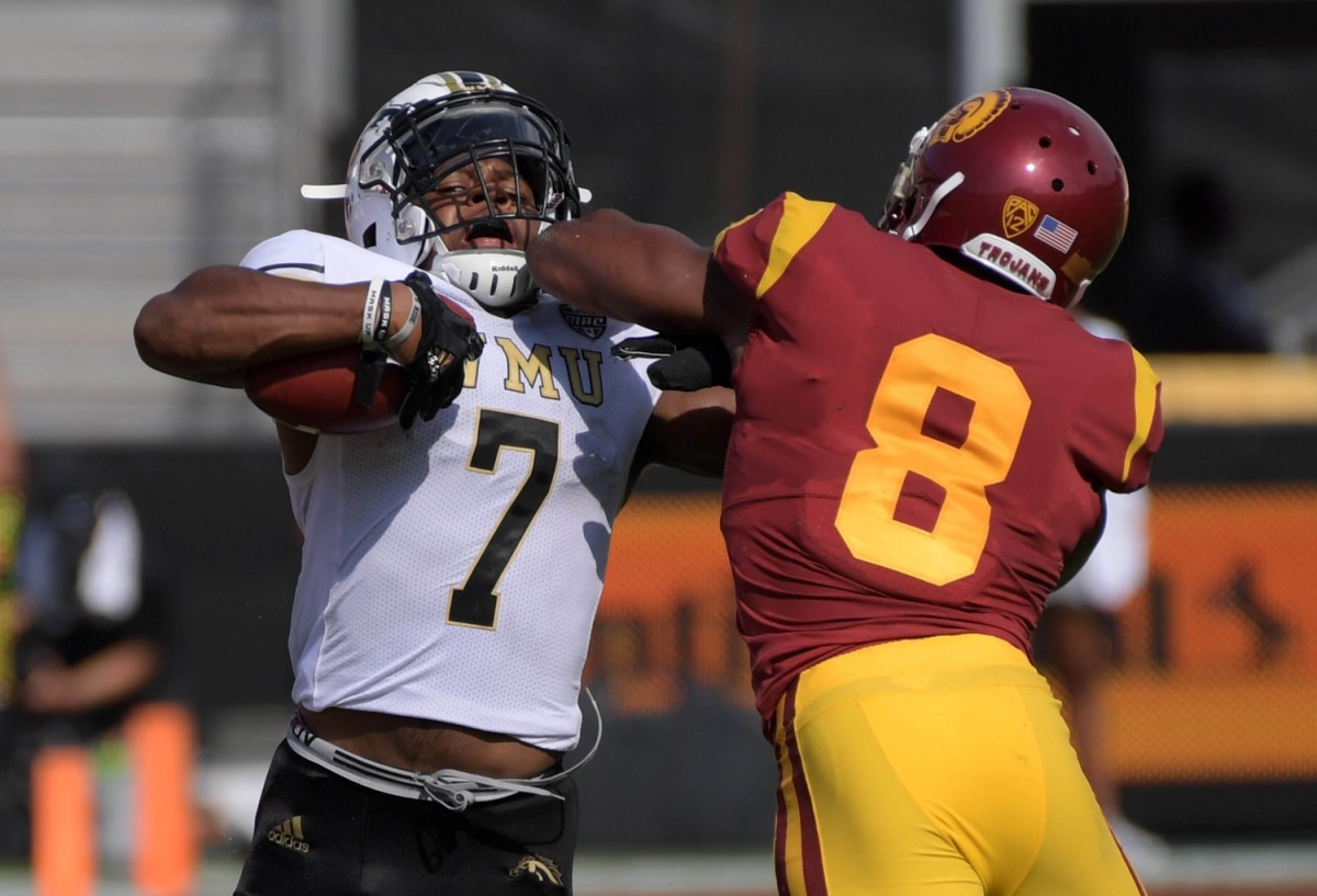 Western Michigan Broncos wide receiver D'Wayne Eskridge (7) is defended by Southern California defensive back Iman Marshall (8). Mandatory Credit: Kirby Lee-USA TODAY Sports