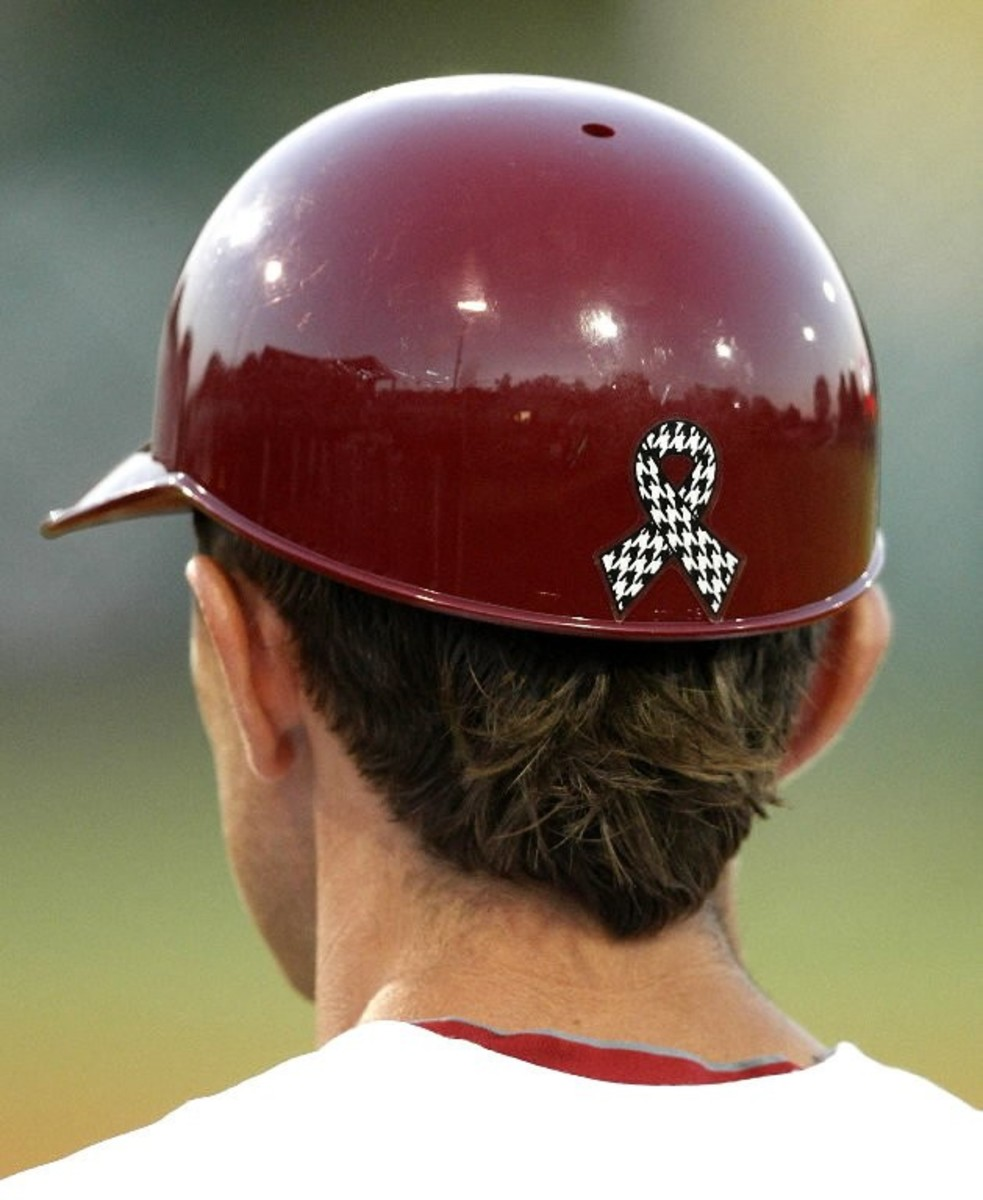 A Tuscaloosa Relief ribbon is sported on the back of an Alabama baseball helmet following the April 27 tornado.