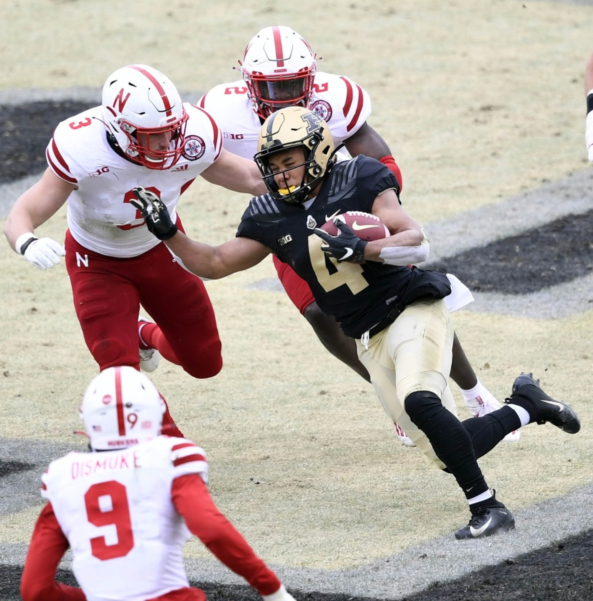 Purdue Boilermakers receiver Rondale Moore (4) attempts to evade tackle against multiple Nebraska Cornhuskers. Mandatory Credit: Marc Lebryk-USA TODAY