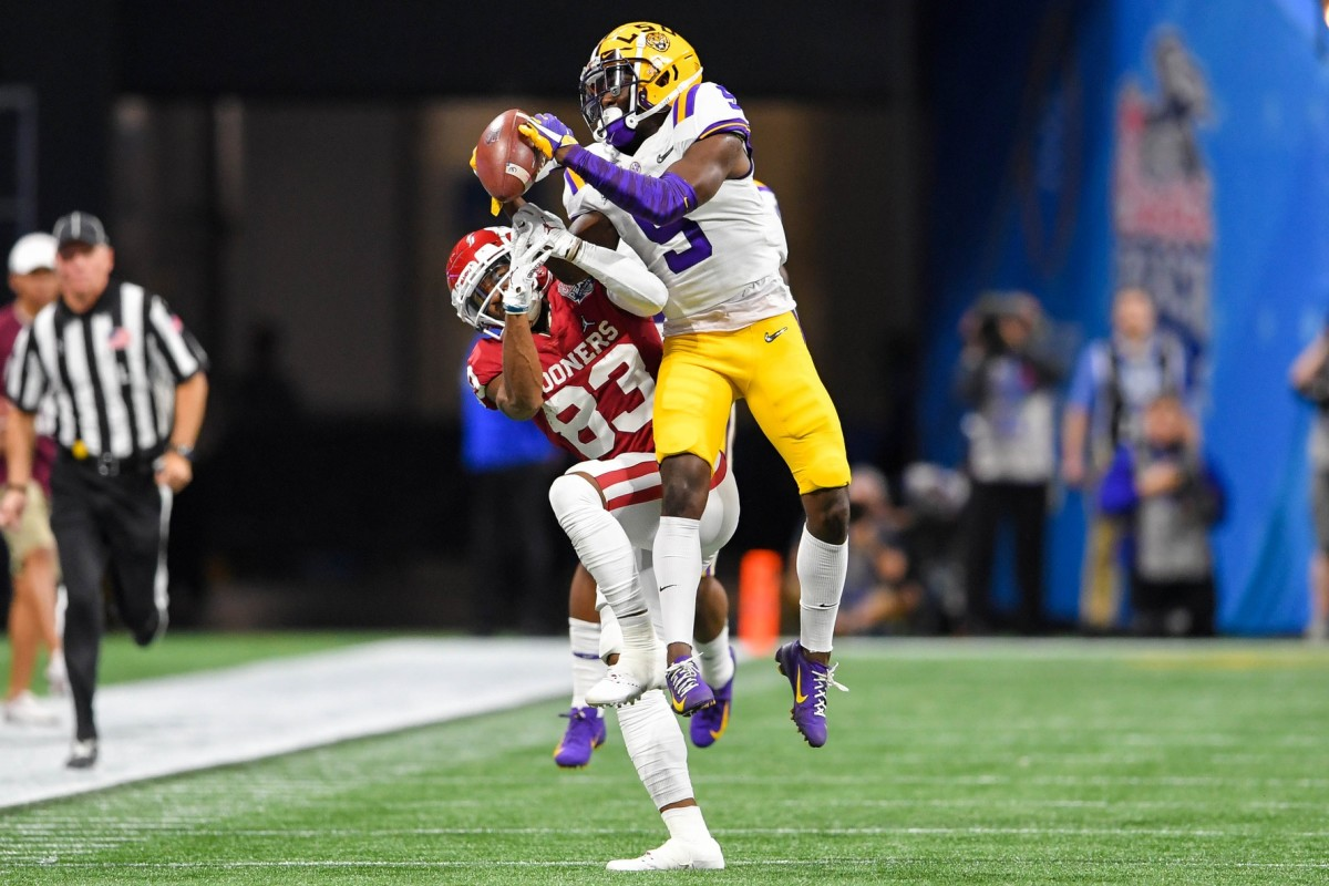 LSU Tigers cornerback Kary Vincent Jr. (5) intercepts a pass intended for Oklahoma receiver Nick Basquine (83) during the playoff semifinal game. Mandatory Credit: Dale Zanine-USA TODAY