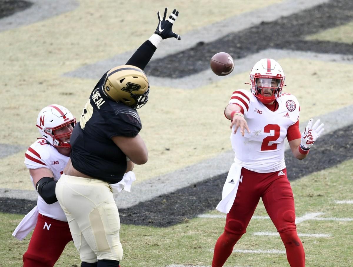 Nebraska Adrian Martinez (2) throws a pass under pressure from Purdue defensive tackle Lorenzo Neal (9). Mandatory Credit: Marc Lebryk-USA TODAY Sports
