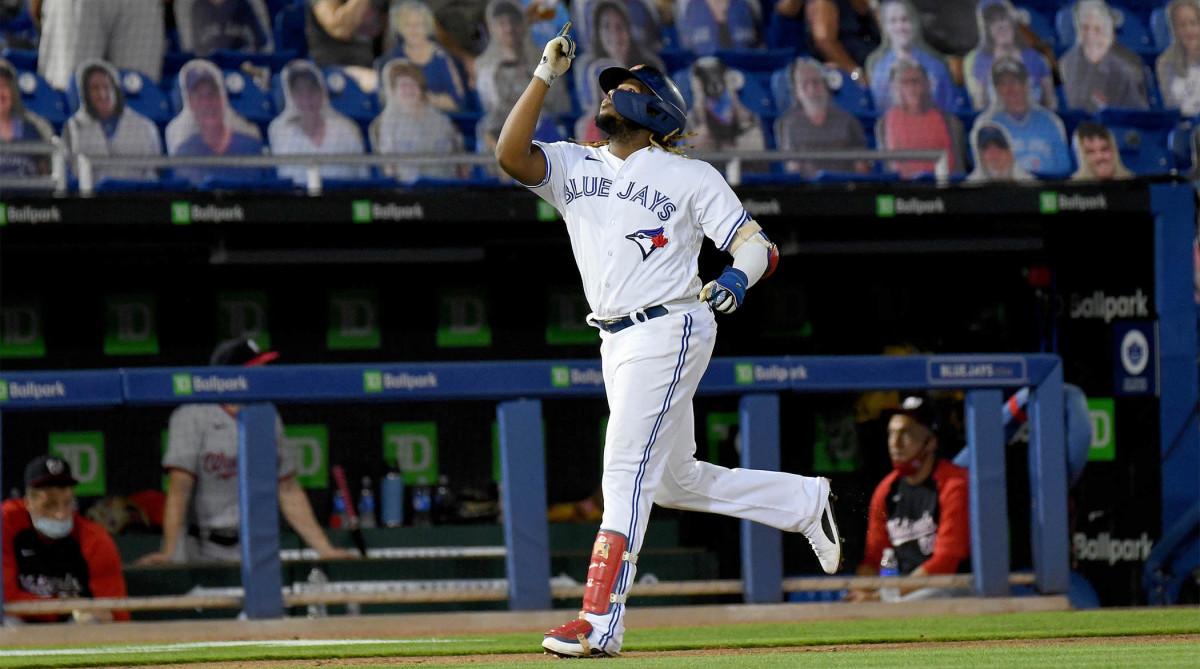 Apr 27, 2021; Dunedin, Florida, CAN; Toronto Blue Jays infielder Vladimir Guerrero Jr. (27) gestures as he rounds the bases after hitting a two-run home run during the seventh inning against the Washington Nationals at TD Ballpark.