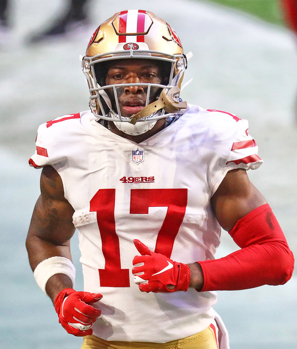 49ers receiver Matt Cole warms up on the sideline during a 2020 game