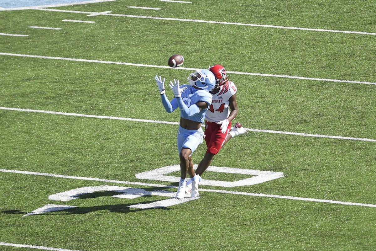 North Carolina Tar Heels receiver Dyami Brown (2) attempts to catch a pass as North Carolina State cornerback Malik Dunlap (24) defends. Mandatory Credit: Bob Donnan-USA TODAY