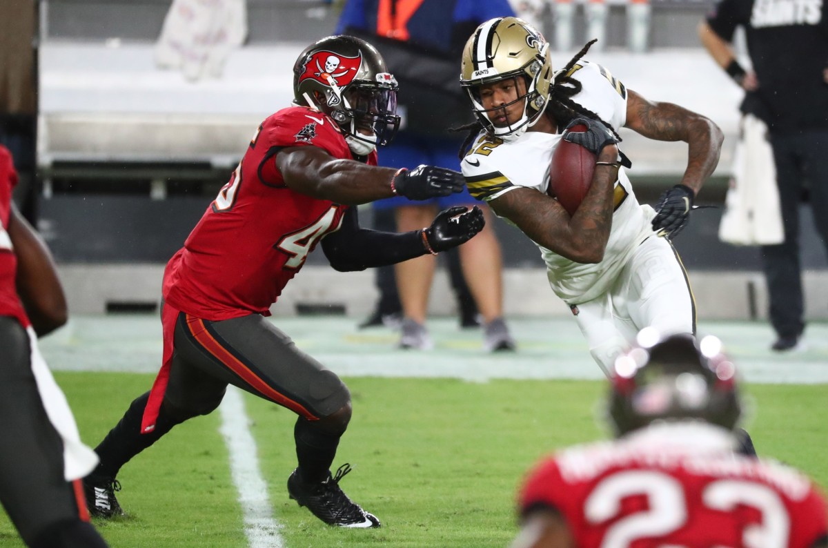New Orleans Saints receiver Marquez Callaway (12) runs the ball as Tampa Bay linebacker Devin White (45) defends. Mandatory Credit: Kim Klement-USA TODAY Sports