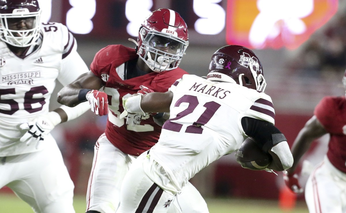 Alabama linebacker Dylan Moses (32) makes a move to tackle Mississippi State running back Jo'quavious Marks (21). Mandatory Credit: Gary Cosby Jr/The Tuscaloosa News via USA TODAY