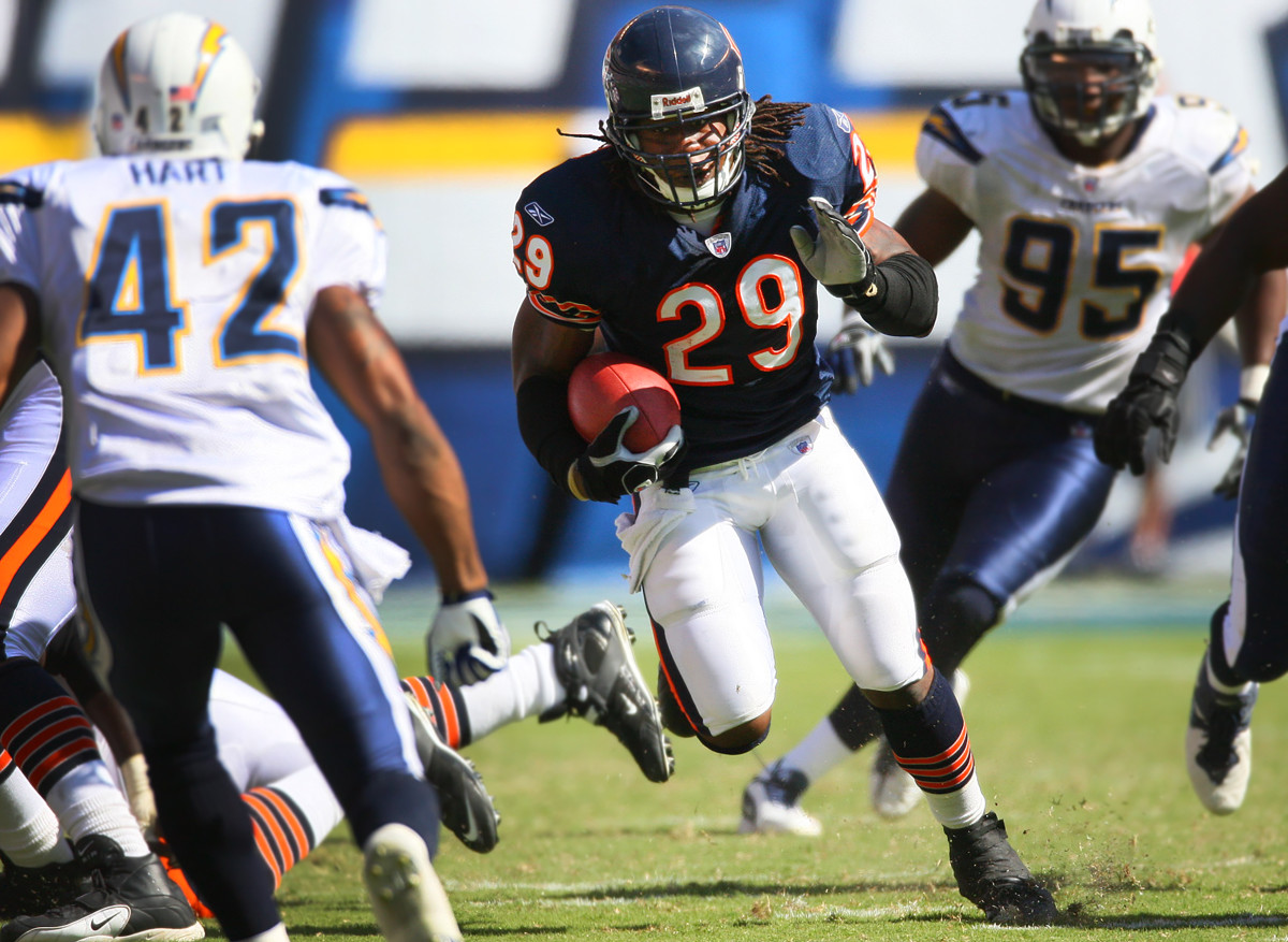 Adrian Peterson of the Bears runs around the edge against the Chargers