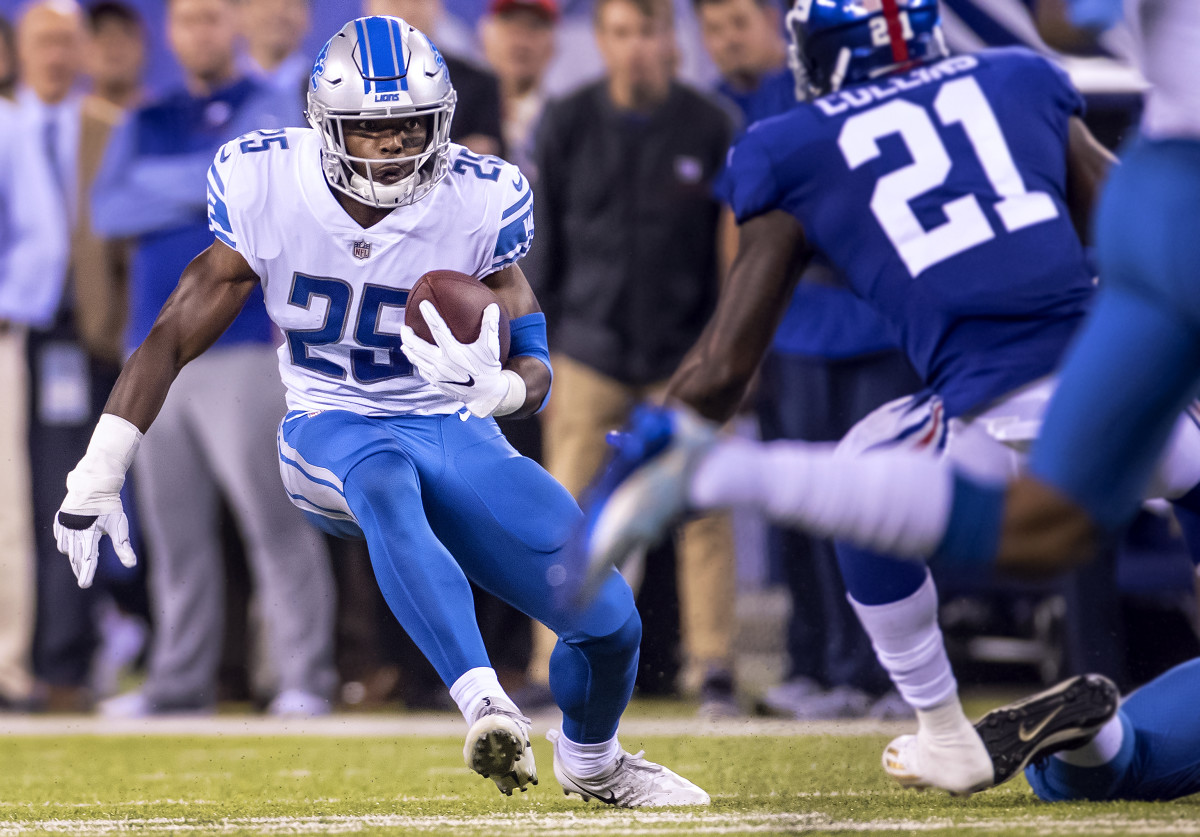 Lions running back Theo Riddick runs against the Giants