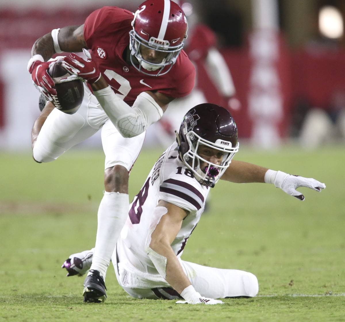 Alabama defensive back Patrick Surtain II (2) makes an interception he returned for a touchdown at Bryant-Denny Stadium during the second half of Alabama's 41-0 win over Mississippi State. The pass was inteded for Mississippi State wide receiver Cameron Gardner (18).