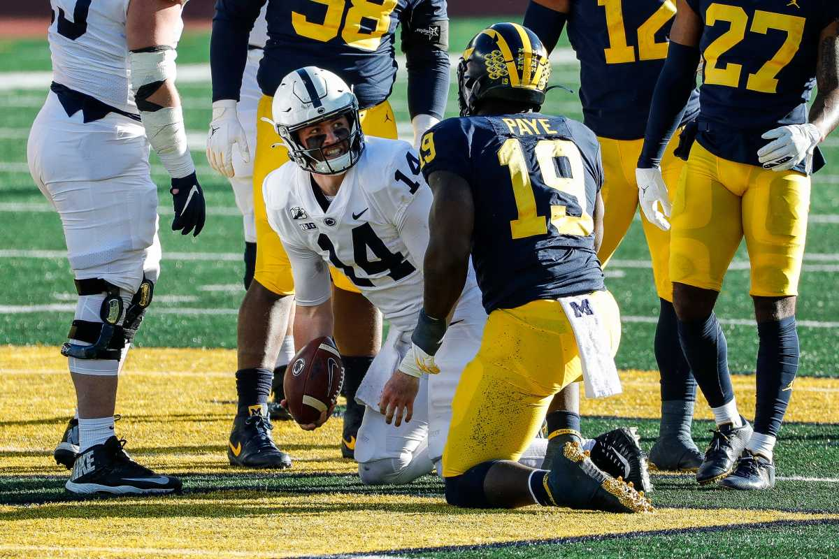 Michigan defensive lineman Kwity Paye tackles Penn State quarterback Sean Clifford during the second half of Michigan's 27-17 loss at Michigan Stadium on Saturday, Nov. 28, 2020.