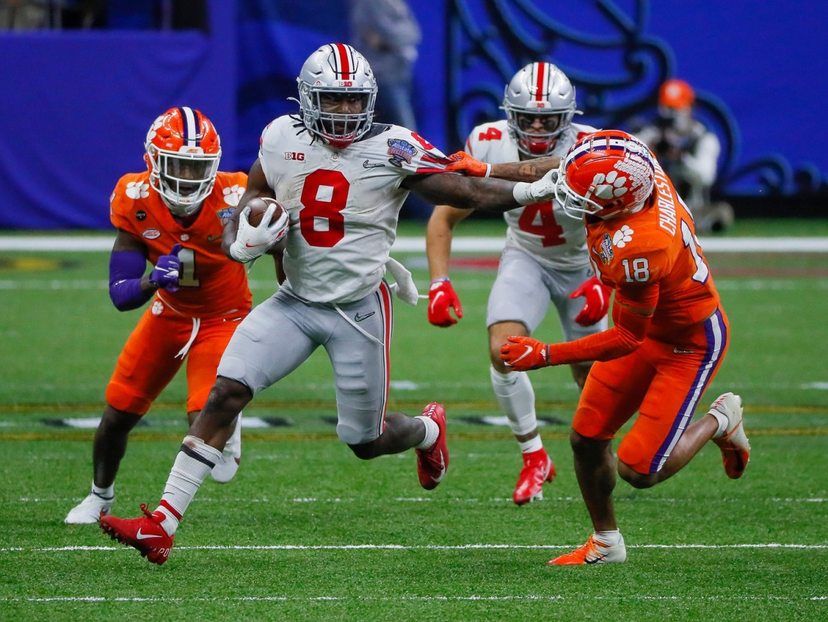 Ohio State running back Trey Sermon (8) carries the ball up field against Clemson during the College Football Playoff semifinal© Kyle Robertson/Columbus Dispatch via Imagn Content Services, LLC