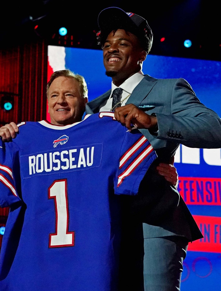 Gregory Rousseau (Miami) with NFL commissioner Roger Goodell after being selected by the Buffalo Bills as the number 30 overall pick in the first round of the 2021 NFL Draft at First Energy Stadium.