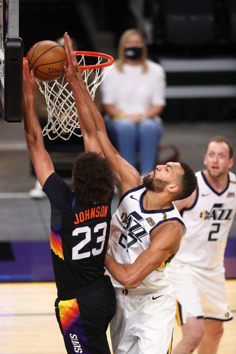 Rudy Gobert (27) blocks a shot against the Phoenix Suns