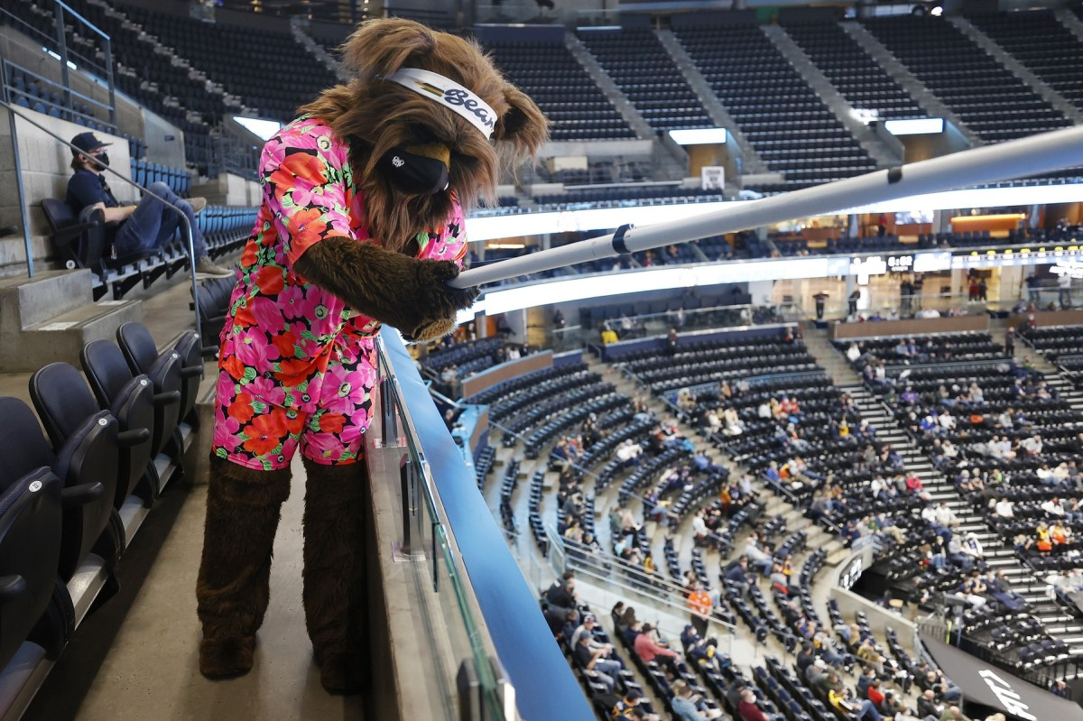 The Utah Jazz mascot, Bear, engages with socially distant fans at Vivint Smart Home Arena