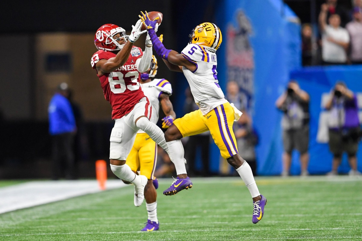 LSU Tigers cornerback Kary Vincent Jr. (5) intercepts a pass intended for Oklahoma receiver Nick Basquine (83) during the 2019 college football playoff semifinal. Mandatory Credit: Dale Zanine-USA TODAY