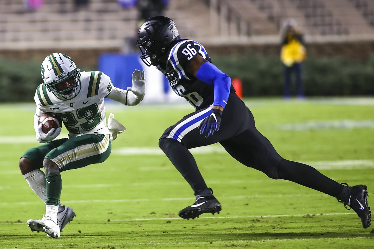 Charlotte 49ers receiver Micaleous Elder (23) runs with the ball while Duke Blue Devils defensive end Chris Rumph II (96) chases. Mandatory Credit: Jaylynn Nash-USA TODAY