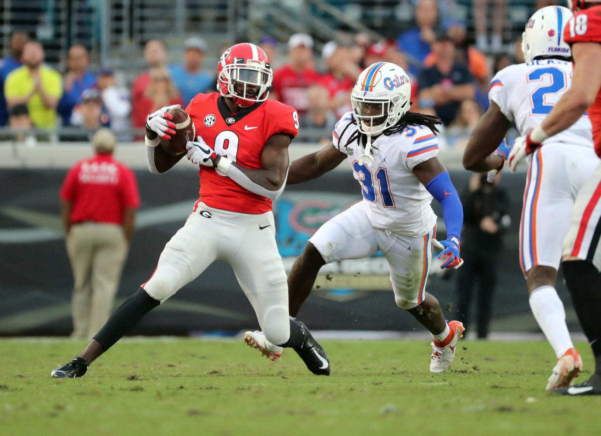 Oct 27, 2018; Jacksonville, FL, USA; Georgia Bulldogs wide receiver Jeremiah Holloman (9) catches the ball against Florida Gators defensive back Shawn Davis (31) during the second half at TIAA Bank Field. Mandatory Credit: Kim Klement-USA TODAY Sports