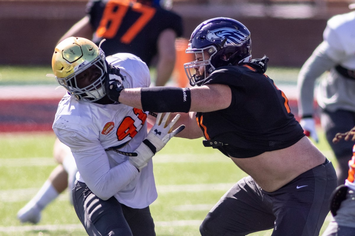 National defensive lineman Ade Ogundeji of Notre Dame (91) drills against National offensive lineman Quinn Meinerz of Wisconsin -Whitewater (71) during National practice at Hancock Whitney Stadium in Mobile, Alabama, USA;