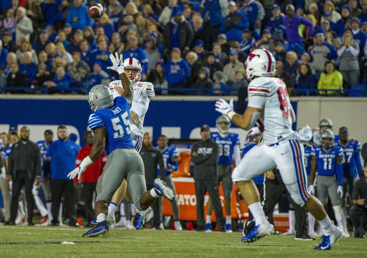 Nov 2, 2019; Memphis, TN, USA; Southern Methodist Mustangs quarterback Shane Buechele (7) passes against Memphis Tigers defensive end Bryce Huff (55) to Southern Methodist Mustangs tight end Kylen Granson (83) during the first half at Liberty Bowl Memorial Stadium.