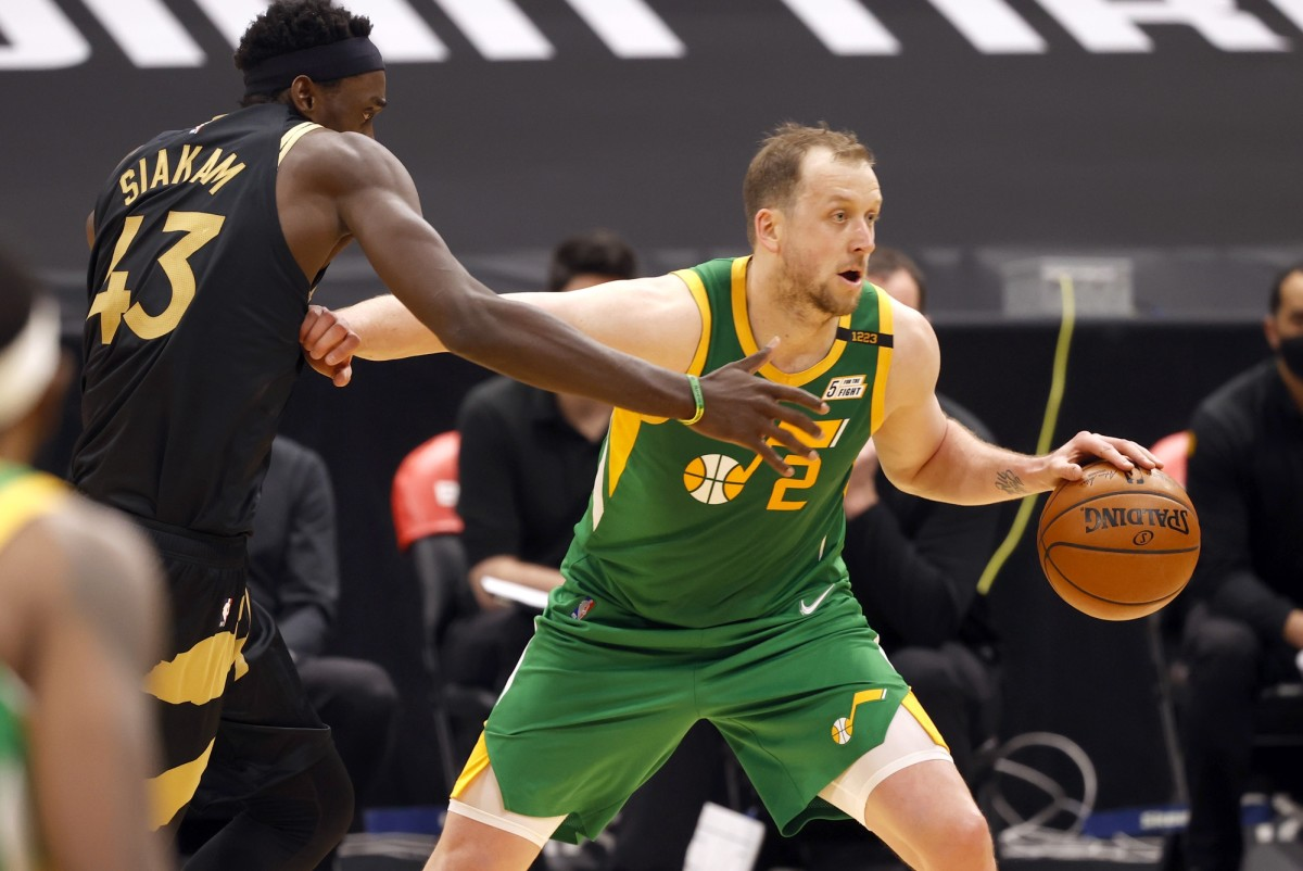 Joe Ingles (2) drives past Pascal Siakam (43) in a game against the Toronto Raptors