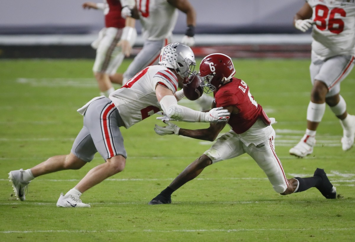 Ohio State Buckeyes linebacker Pete Werner (20) breaks up a pass intended for Alabama receiver DeVonta Smith (6) during the College Football National Championship. Mandatory Credit: Kyle Robertson/The Columbus Dispatch/USA TODAY