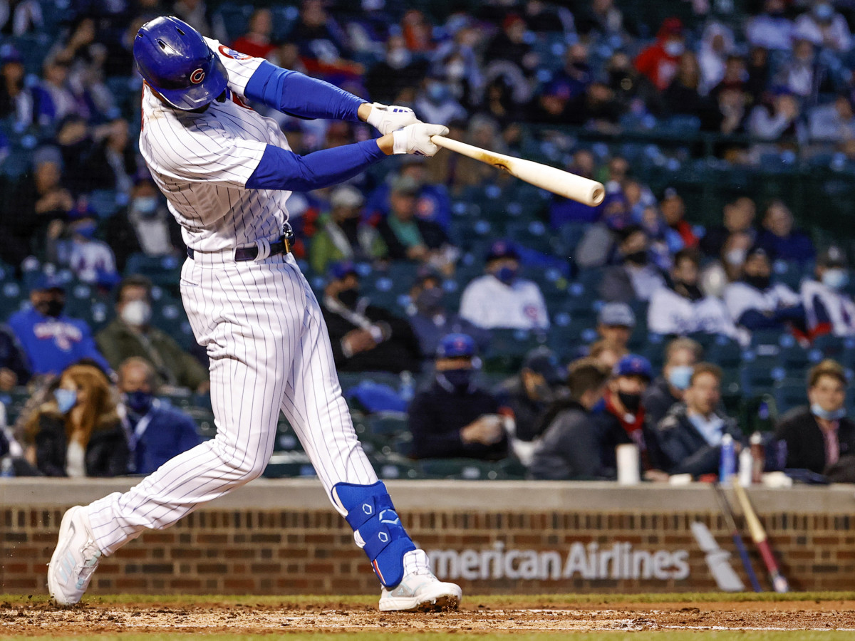 Apr 22, 2021; Chicago, Illinois, USA; Chicago Cubs third baseman Kris Bryant (17) hits a two-RBI double against the New York Mets during the third inning at Wrigley Field.