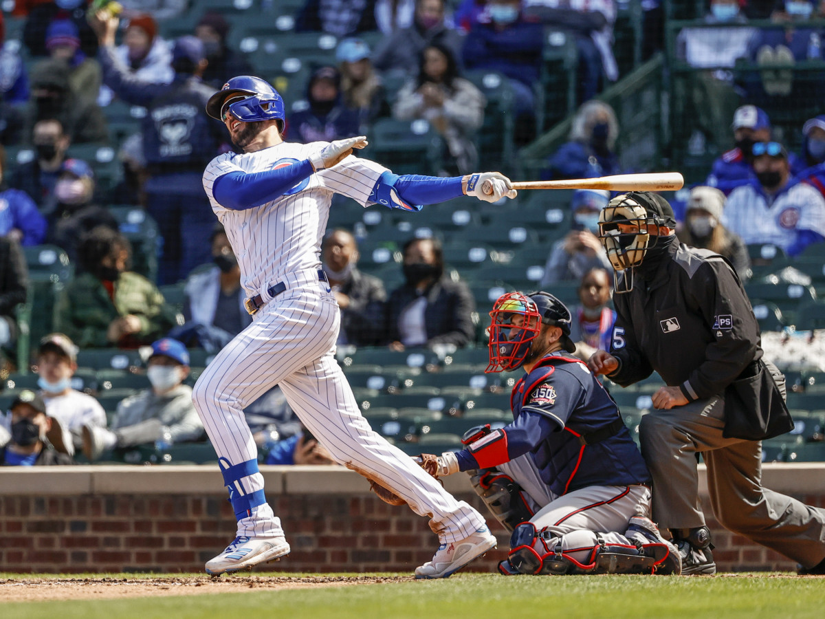 Apr 17, 2021; Chicago, Illinois, USA; Chicago Cubs third baseman Kris Bryant (17) hits a two-run home run against the Atlanta Braves during the fifth inning at Wrigley Field.