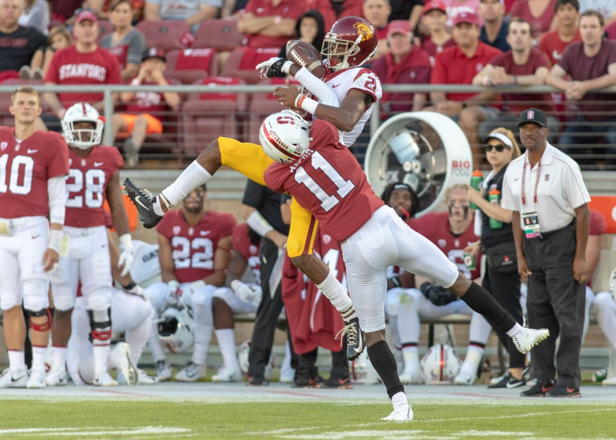 Stanford Cardinal cornerback Paulson Adebo (11) strips the ball from USC receiver Tyler Vaughns (21). Mandatory Credit: Neville E. Guard-USA TODAY