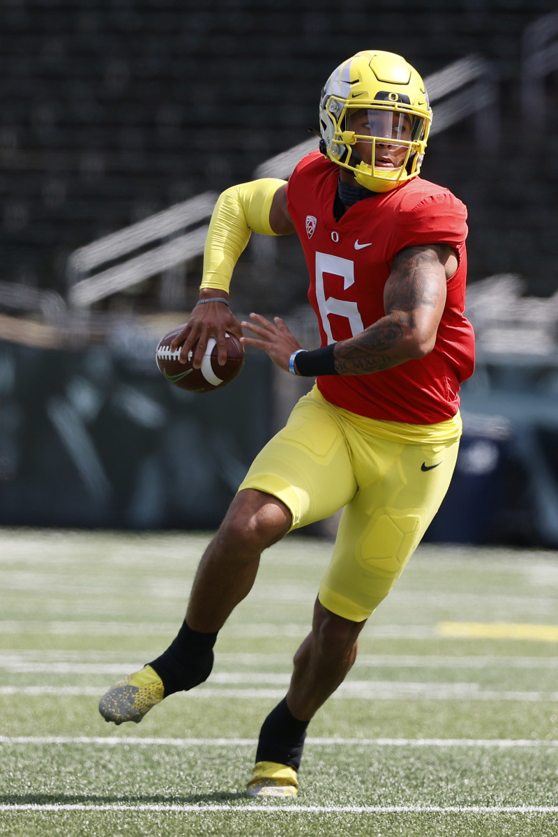 Quarterback Robby Ashford loads up for a throw on the run in Oregon football's spring game.