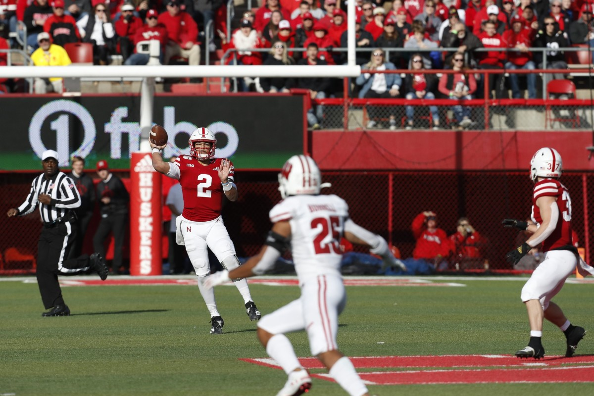 Nebraska quarterback Adrian Martinez (2) throws against Wisconsin Badgers safety Eric Burrell (25). Mandatory Credit: Bruce Thorson-USA TODAY Sports
