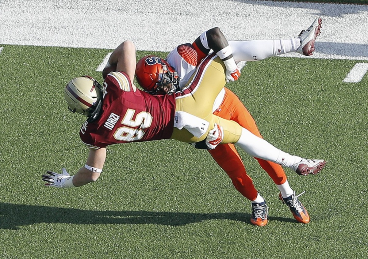 Boston College tight end Korab Idrizi (85) is tackled by Syracuse defensive back Trill Williams. Mandatory Credit: Winslow Townson-USA TODAY