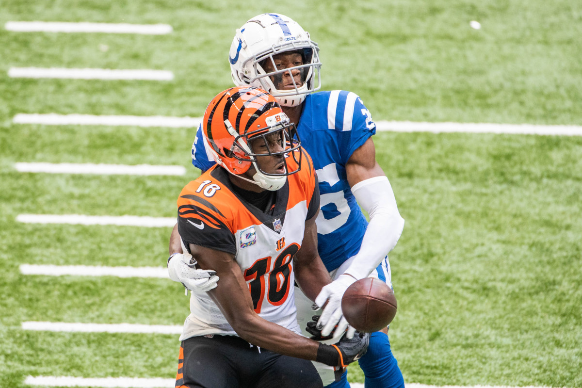 Oct 18, 2020; Indianapolis, Indiana, USA; Indianapolis Colts cornerback Rock Ya-Sin (26) knocks the ball out of the hands of Cincinnati Bengals wide receiver A.J. Green (18) in the second half at Lucas Oil Stadium.