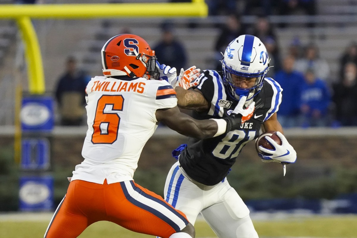 Duke receiver Aaron Young (81) runs with the ball against Syracuse Orange defensive back Trill Williams (6). Mandatory Credit: James Guillory-USA TODAY