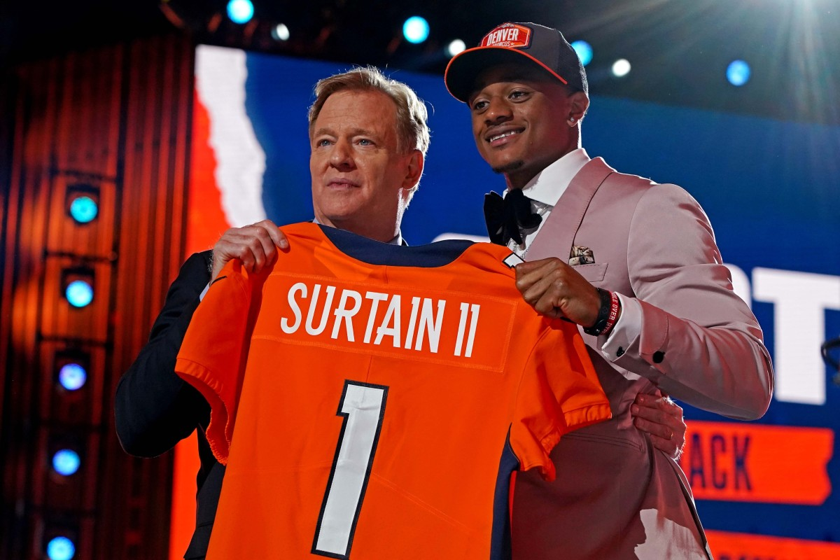 Pat Sutrain Jr. (Alabama) with NFL commissioner Roger Goodell after being selected by Denver Broncos as the number nine overall pick in the first round of the 2021 NFL Draft at First Energy Stadium.