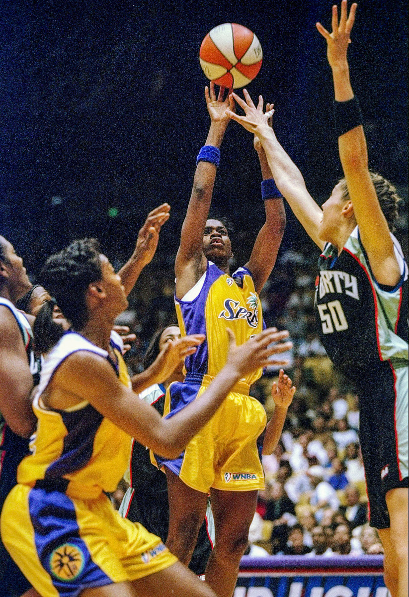 Penny Toler shoots the first bucket of the first WNBA game