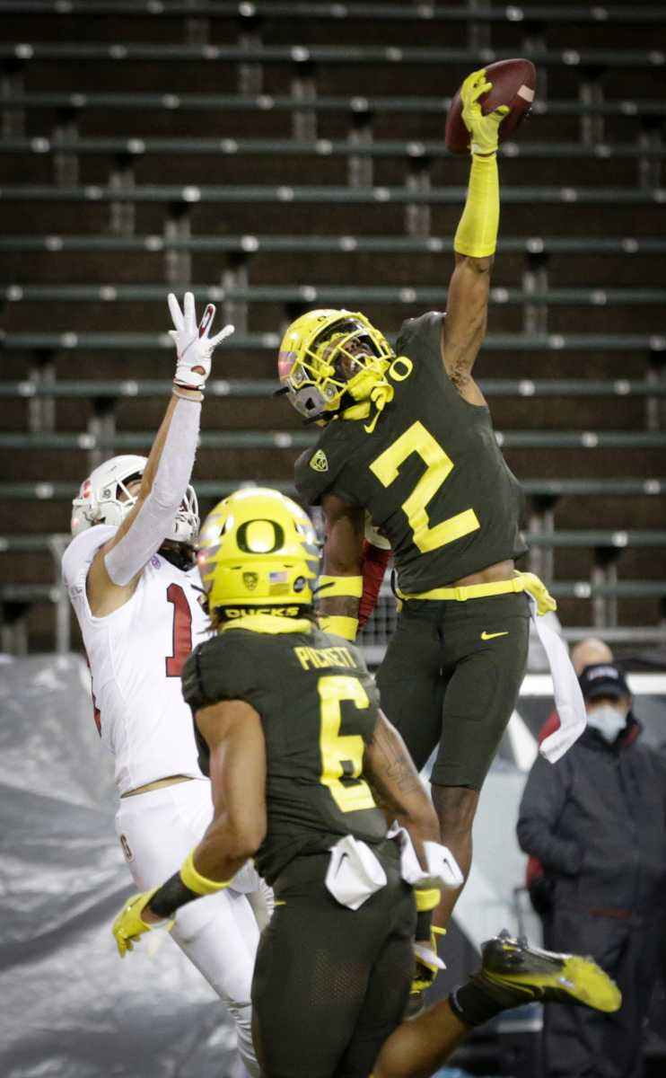 Mykael Wright (2), breaks up a touchdown pass intended for Stanford's Simi Fehoko (13) at Autzen Stadium in Eugene, Oregon on November 7, 2020.
