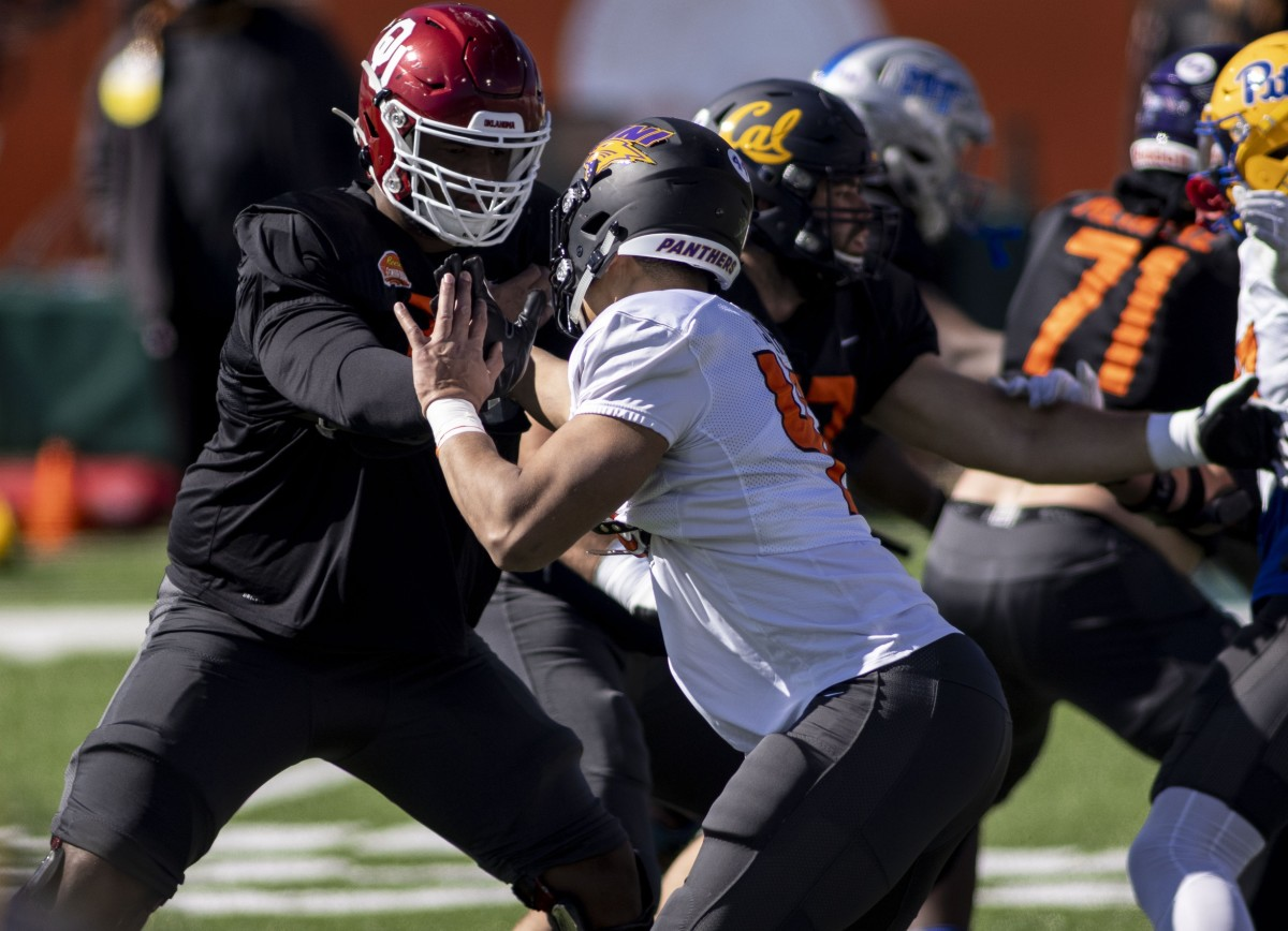 Jan 28, 2021; Mobile, Alabama, USA; National offensive lineman Adrian Ealy of Oklahoma (79) works against National defensive lineman Elerson Smith of Northern Iowa (47) during National practice at Hancock Whitney Stadium.