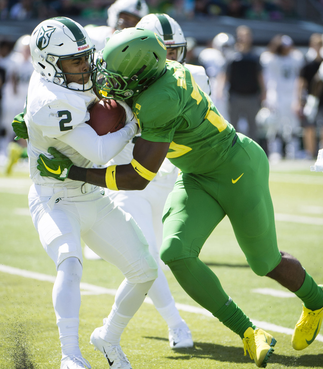 Adrian Jackson tackles wide receiver Antwone Williams in a game against Portland State in 2018.