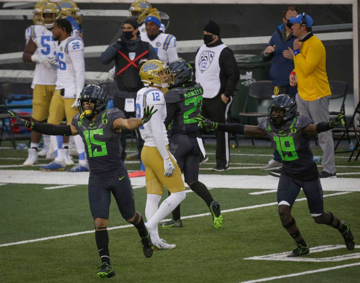 Bennett Williams (15) celebrates an incomplete pass on fourth down against the UCLA Bruins at Autzen Stadium on November 21, 2020. Oregon would hang on to win a thriller 38-35.