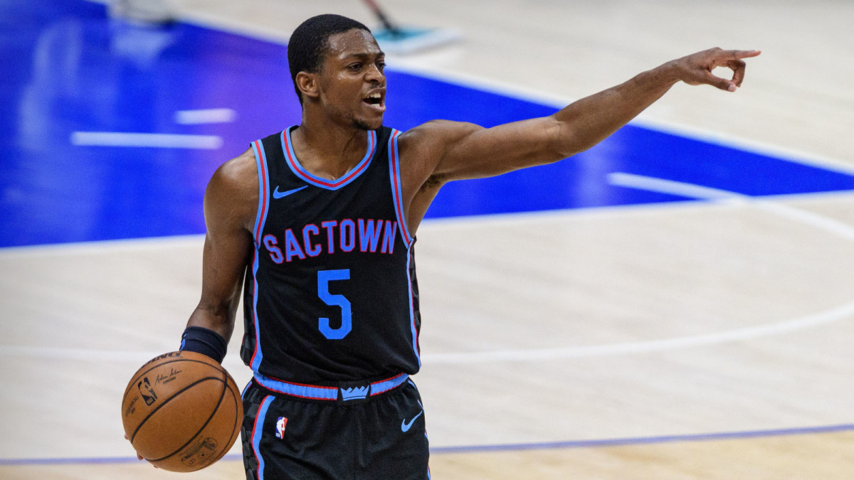 Sacramento Kings point guard De'Aaron Fox holding a basketball