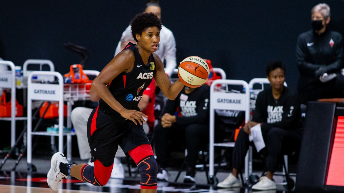 Aces star Angel McCoughty dribbles down the court during a 2020 playoff game