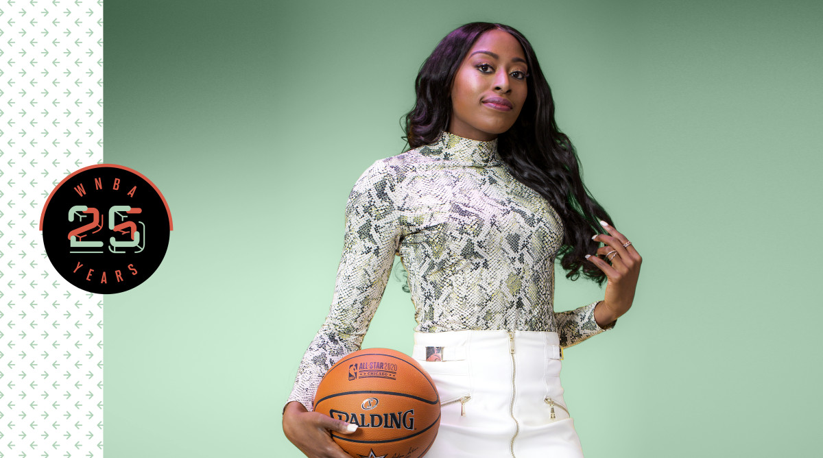 Chiney Ogwumike in street clothes holding a basketball