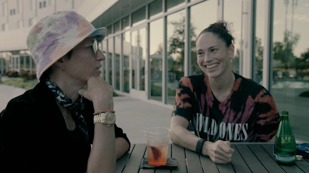 Megan Rapinoe and Sue Bird sitting at a table