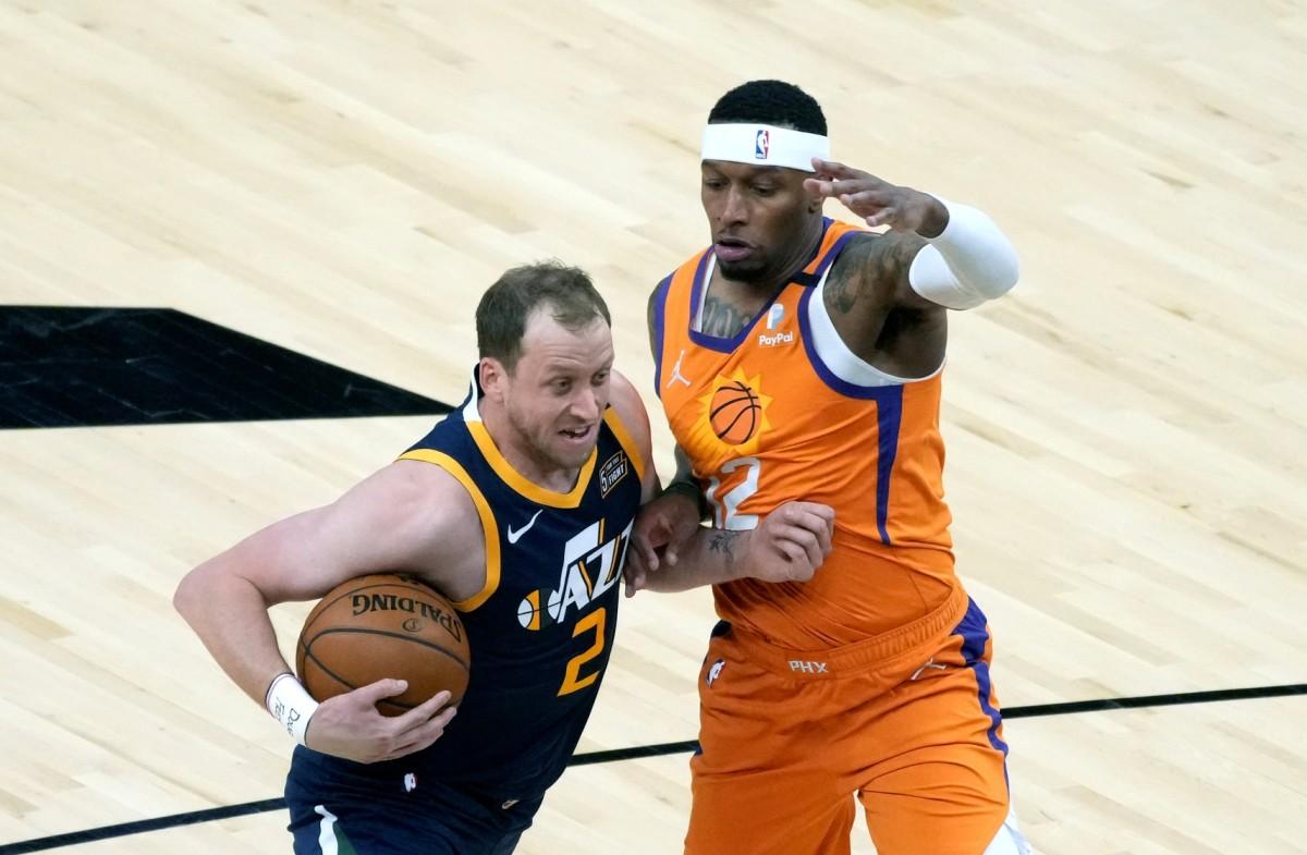 Joe Ingles (2) jostles for positioning against the Phoenix Suns